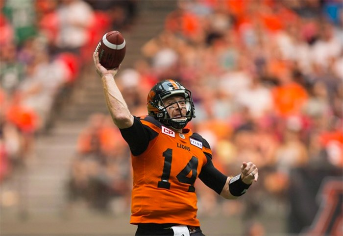 B.C. Lions' quarterback Travis Lulay passes against the Saskatchewan Roughriders during the first half of a CFL football game in Vancouver on August 5, 2017. THE CANADIAN PRESS/Darryl Dyck
