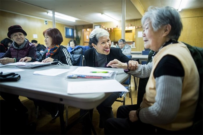Amie Peacock, centre, founder of the volunteer group Beyond the Conversation, speaks with a senior citizen during a weekly group meeting to help people practice their English skills, combat social isolation and foster relationships, in Vancouver, B.C., on Friday February 23, 2018. The problem of social isolation, which can have serious consequences on a person's mental health and mortality, gained international awareness when the United Kingdom appointed a minister of loneliness in January. Vancouver's Seniors Advisory Committee has developed a report on the issue and delivered its recommendations to city council last month. THE CANADIAN PRESS/Darryl Dyck