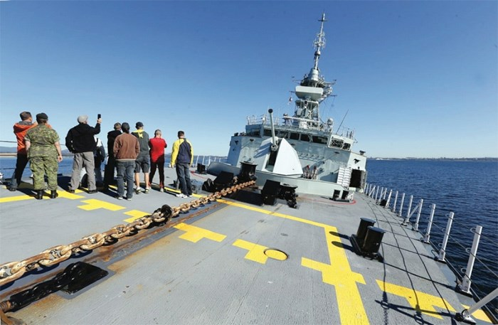 Visitors tour the deck of HMCS Calgary.   Photograph By BRUCE STOTESBURY, Times Colonist