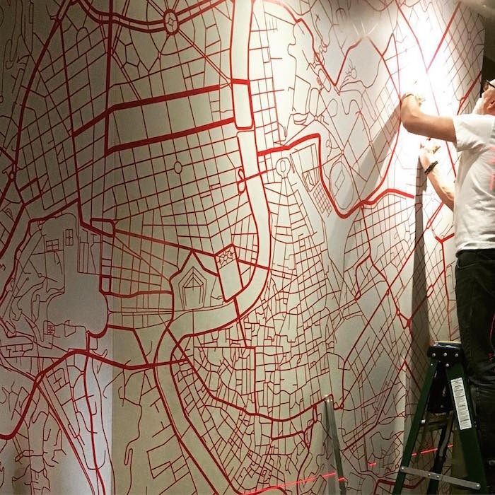 A map of Italian roads serves as wall decor (