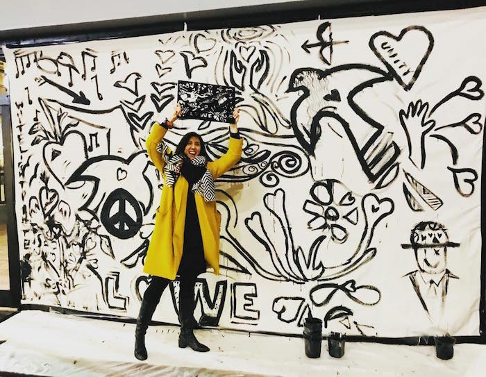 Artist Aurelia Bizouard in front of her canvas (