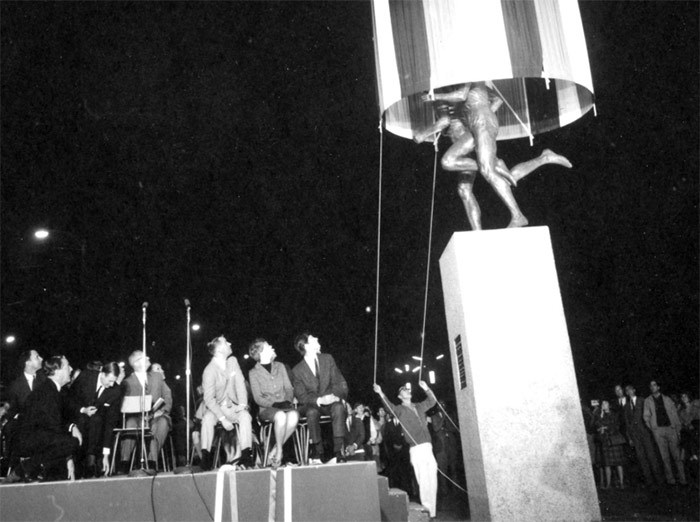 Dignitaries watch as a curtain is pulled up to reveal the Miracle Mile statue by sculptor Jack Harman at Hastings Park in 1967. The statue has been moved, this time closer to Empire Field where the miraculous race was held in 61 years ago. Photo Vancouver Archives 180-3937.03