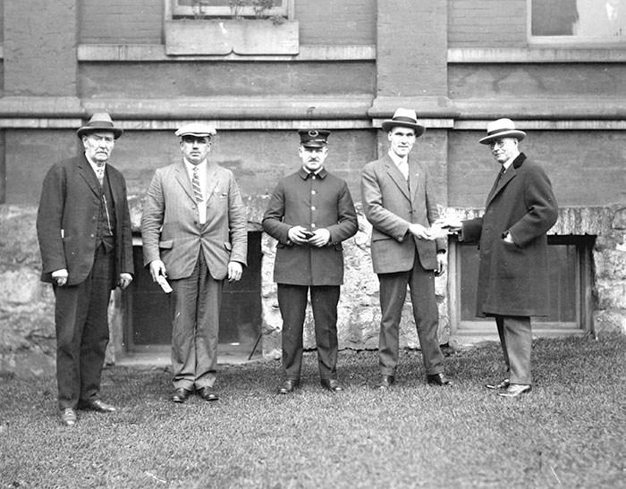 Mayor L.D. Taylor awarding medals, ca. 1931. Vancouver Archives Item: CVA 1477-162