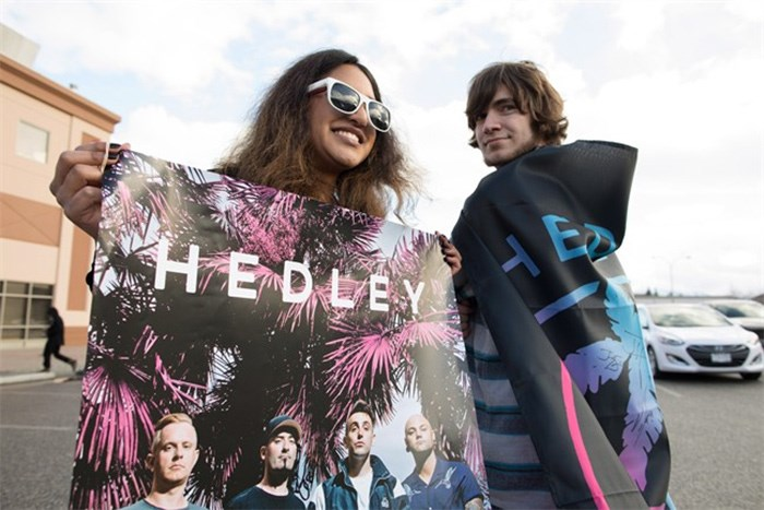 Hedley fan's Charene Gonschorek, left, and Brandon Krys show their support for the band before the final concert of their current tour in Kelowna, B.C., on Friday, March 23, 2018. The band's tour has been overshadowed by allegations of sexual misconduct. The band was dropped from their management company, The Feldman Agency, their songs were pulled from radio stations across the country and a planned performance at the Juno Awards was cancelled. Following the tour, Hedley has announced that they will be taking an indefinite hiatus from music. THE CANADIAN PRESS/Jeff Bassett