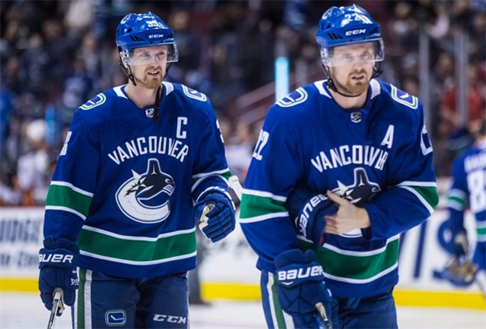 Vancouver Canucks' Henrik Sedin, left, and his twin brother Daniel Sedin, both of Sweden, skate before an NHL hockey game against the Anaheim Ducks in Vancouver on March 27, 2018. THE CANADIAN PRESS/Darryl Dyck