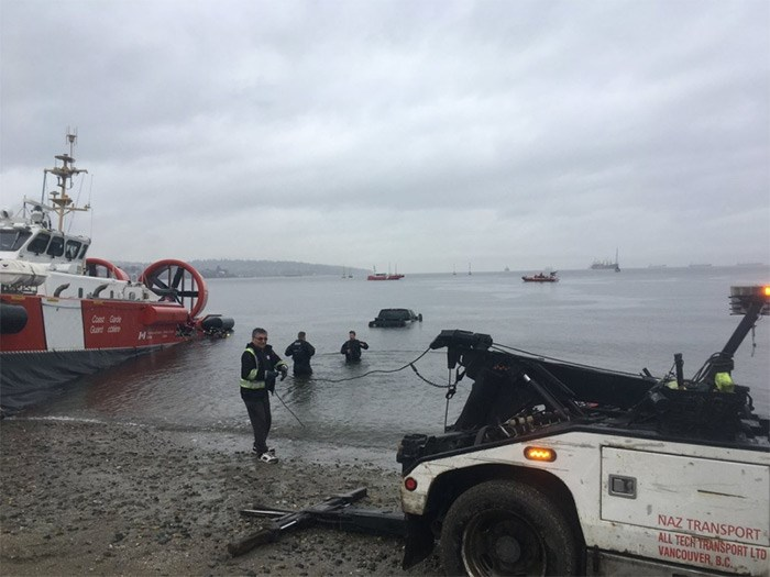 Vancouver Police are trying to determine how an unoccupied, stolen truck ended up in the waters off of Kits Beach. Photo: Cst. Goddard.