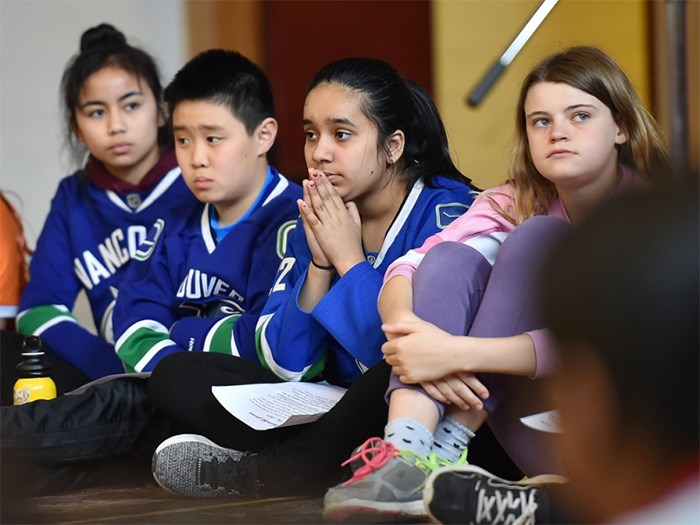 Grenfell elementary students, from left, Stephanie Sarranquin, Brydan Yuen, Aalam Khangura and Coral Heatherington spoke to the importance of empathy and compassion at an assembly Thursday that launched the school's fundraising efforts for the Humboldt Broncos hockey team.   Photograph By Dan Toulgoet
