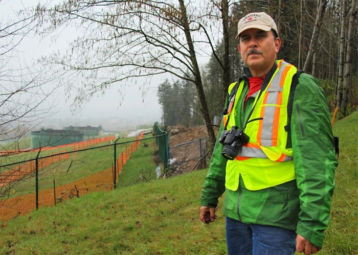 Streamkeeper John Preissl stands north east of Trans Mountain's terminal in Burnaby. Excavation at the site behind him may have led to a sediment spill downstream in Silver Creek.   Photograph By Lauren Boothby