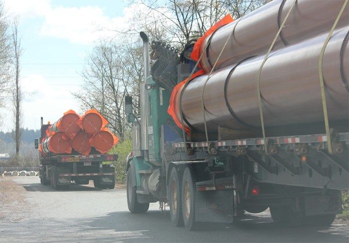 Truckloads of pipes arrive at Kinder Morgan's staging facility in New Westminster on April 12. Additional pipe shipments were spotted Monday.   Photograph By Contributed, Peter McCartney
