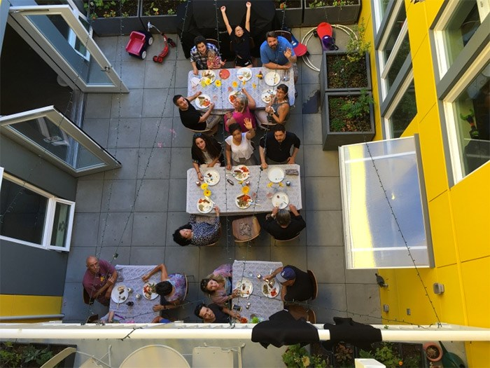 Residents of Capitol Hill Urban Cohousing enjoy dinner in their courtyard. Photo Schemata Workshop