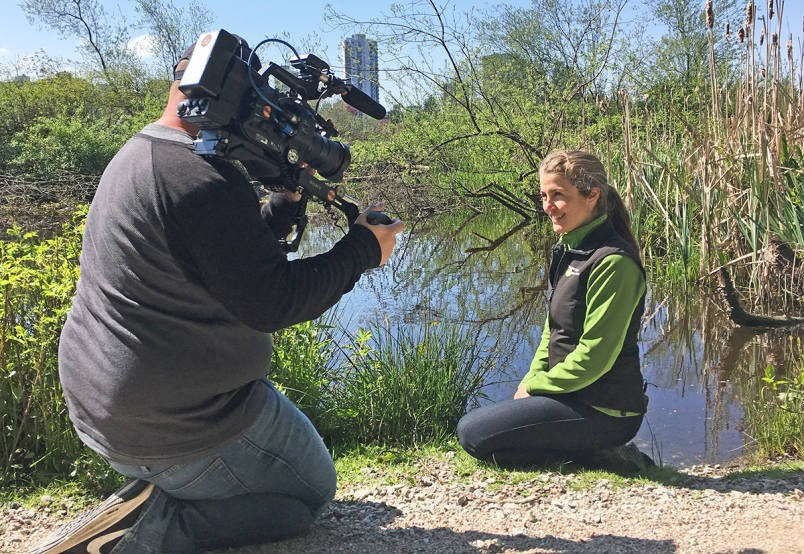 Celina Starnes of the Stanley Park Ecology Society describes how the blob of Lost Lagoon came to be to director of photography Mark Goodhew of the Discovery Channel.