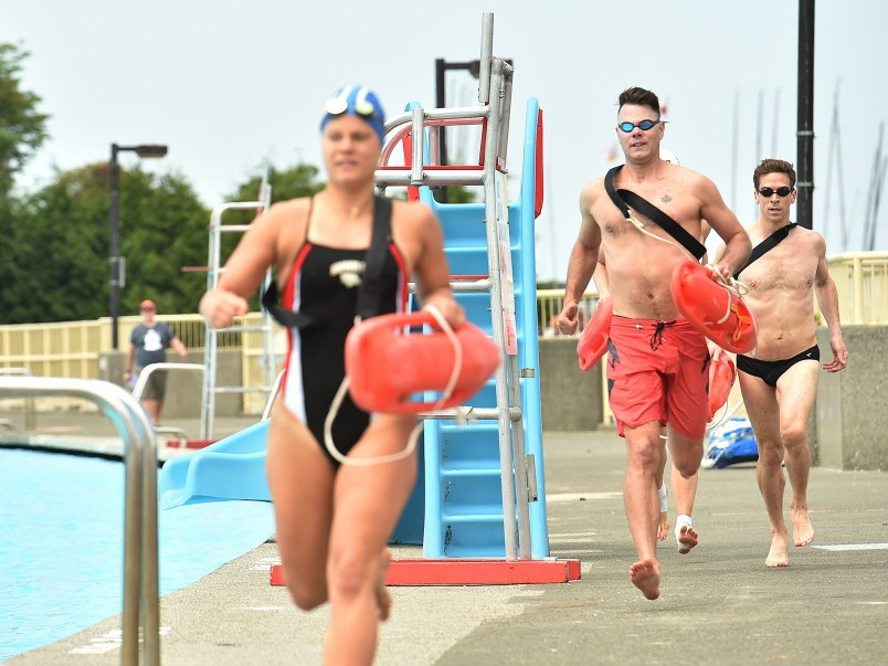 Lifeguards were put through the paces Friday in advance of Kits Pool's opening on Saturday, May 19. Photograph By DAN TOULGOET
