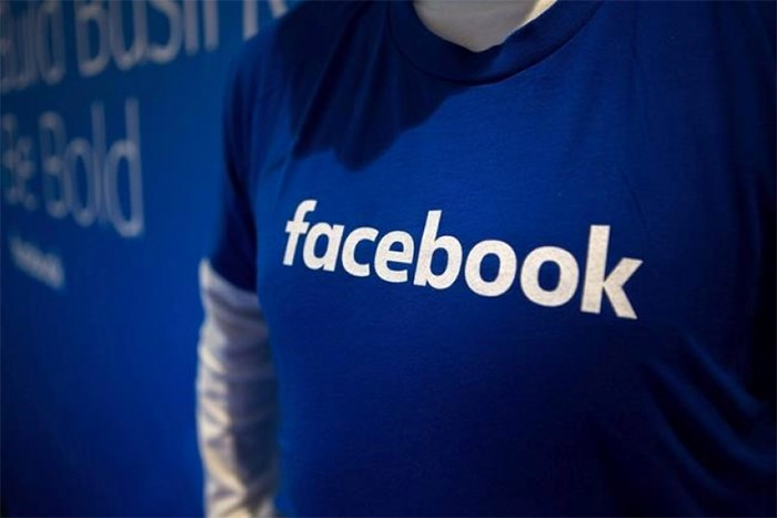 Guests are welcomed by people in Facebook shirts as they arrive at the Facebook Canadian Summit in Toronto on Wednesday, March 28, 2018. THE CANADIAN PRESS/Chris Donovan