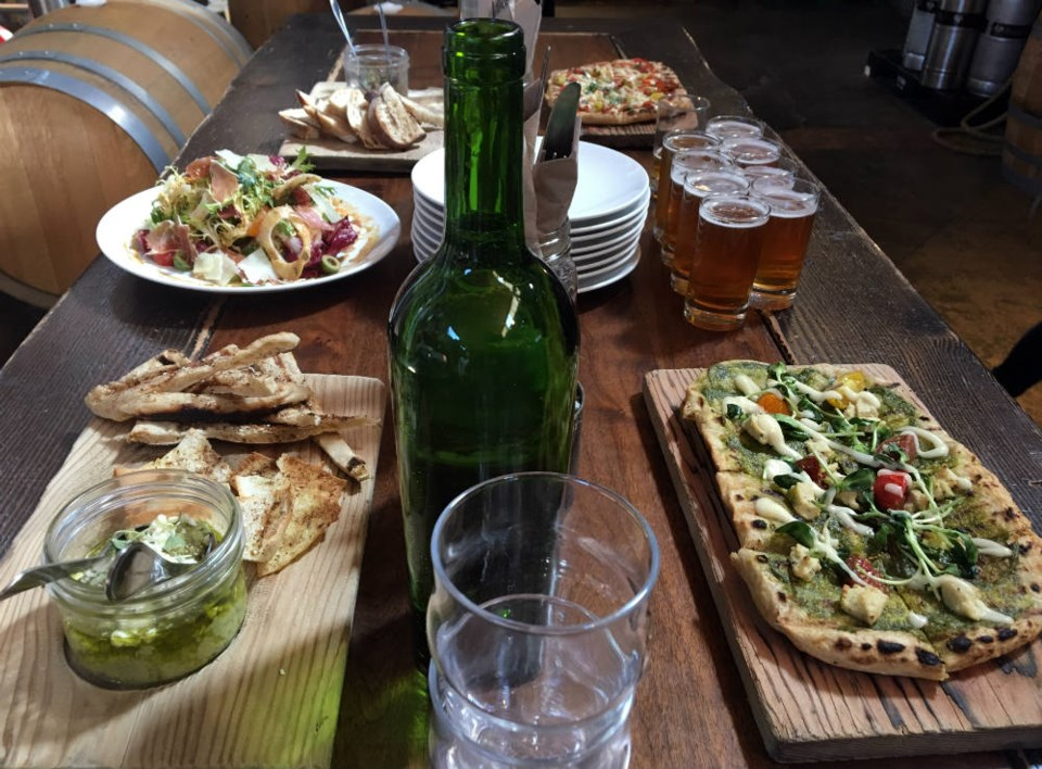 Beer, pizza and other appetizers at Postmark Brewing. Photo Melissa Shaw