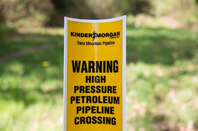 A sign where buried pipelines are located is seen in Burnaby B.C., just outside the Kinder Morgan location Thursday, April 26, 2018. Prime Minister Justin Trudeau insists his government is going to get the Trans Mountain pipeline expansion built but still has nothing to say about how even as Kinder Morgan's deadline clock ticks ever closer to the end. THE CANADIAN PRESS/Jonathan Hayward