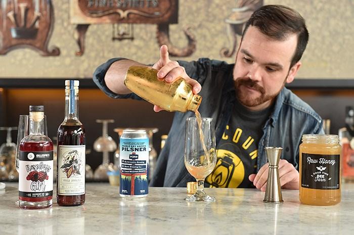 Bartender Shaun Layton works his magic. Photo: Dan Toulgoet.