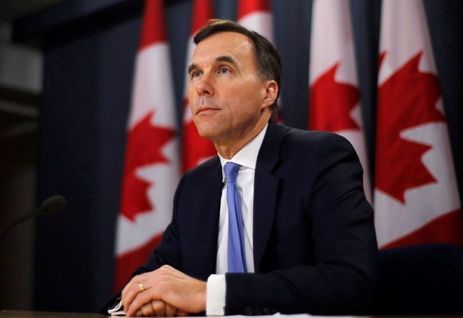 Finance Minister Bill Morneau speaks about the Trans Mountain Expansion project at a press conference in Ottawa on May 16, 2018. Finance Minister Bill Morneau will announce as early as Tuesday morning where the government plans to go with Kinder Morgan to ensure the controversial Trans Mountain pipeline expansion gets built.There are three options on the table, which include the government buying and building the expansion, then selling it once it's complete; and buying it on an interim basis, then selling it to investors and leaving them to handle the construction. THE CANADIAN PRESS/Patrick Doyle