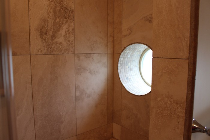 A porthole window in the shower (Lindsay William-Ross/Vancouver Is Awesome)