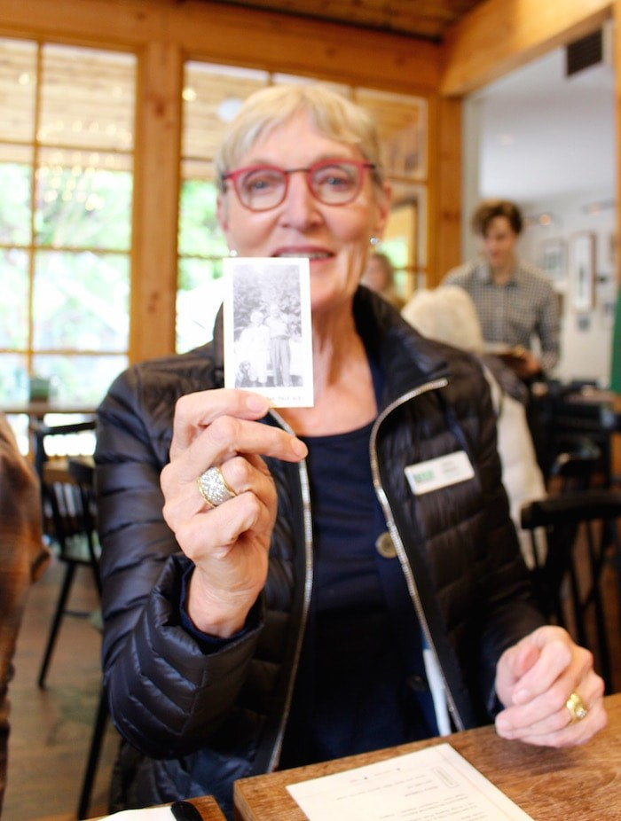 Nancy Stibbard holds a photo of herself and her dad being used as a label on beer flights (Lindsay William-Ross/Vancouver Is Awesome)