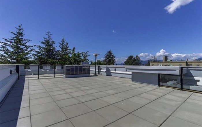 The roof terrace of this East Vancouver has an outdoor kitchen, wet bar and 360-degree views. Listing agent: David Caron