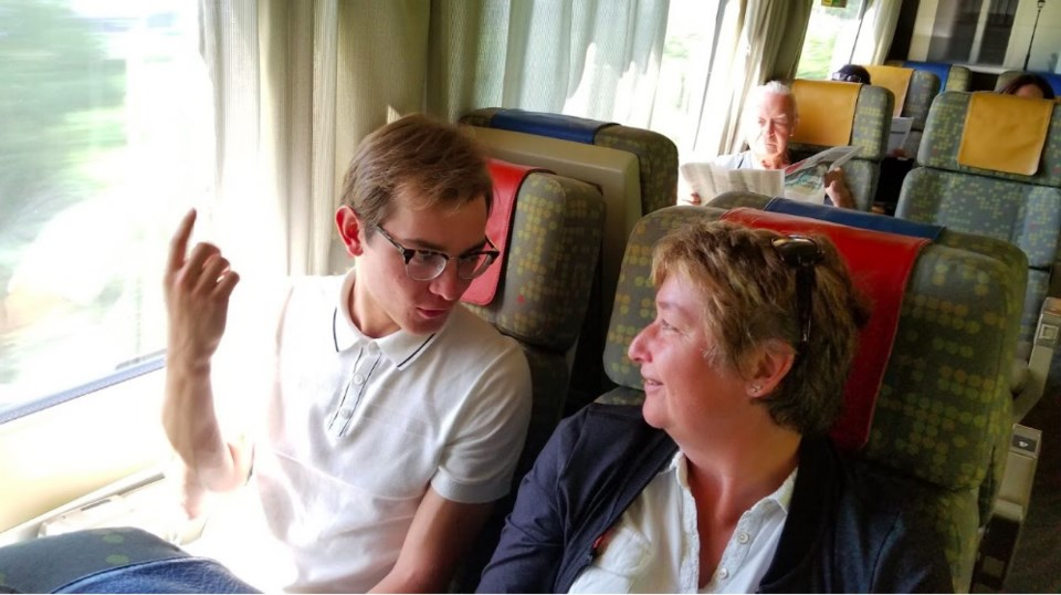 Jacob Wallace chats with passenger Sharon Chapman. Photo Summer By Rail