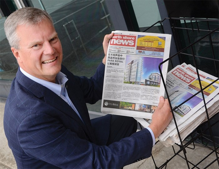 North Shore News publisher Peter Kvarnstrom picks up a mock-up of the weekly Chinese edition, which makes its debut July 5. photo Cindy Goodman, North Shore News