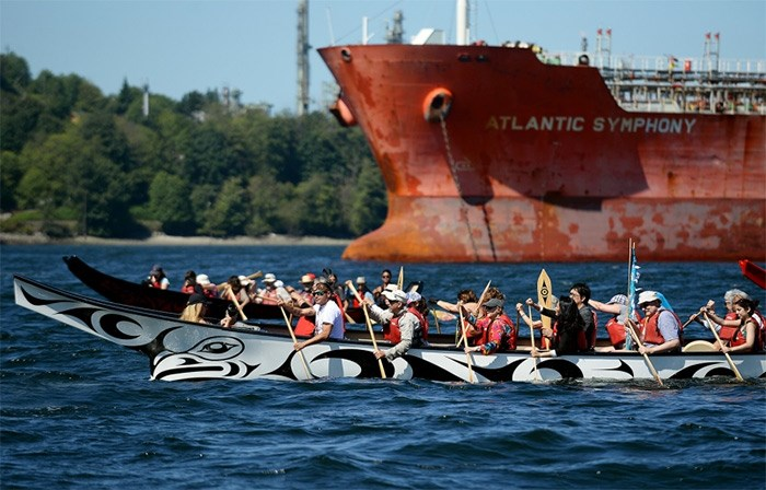 Members of Coast Salish Nations lead a flotilla from North Vancouver to Trans Mountain's Westridge marine terminal in Burnaby to perform a ceremony on the water.