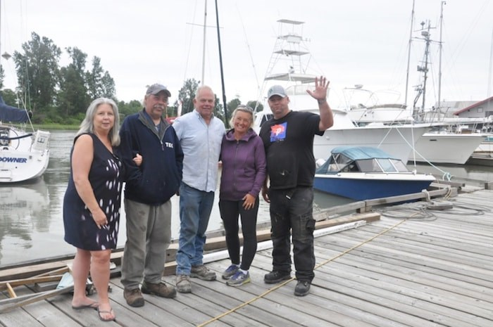 Roberto Farinha (Far right), founder of Richmond Harbour Ferry, works with president of Bridges Marina Paul Palmer (third left) and his staff to build Richmond's private pedestrian ferry system. Daisy Xiong photo