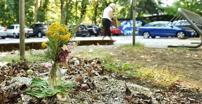 A small memorial for the 39-year-old woman who died Monday after crawling into a clothing donation bin outside West Point Grey Community Centre. Photo Dan Toulgoet