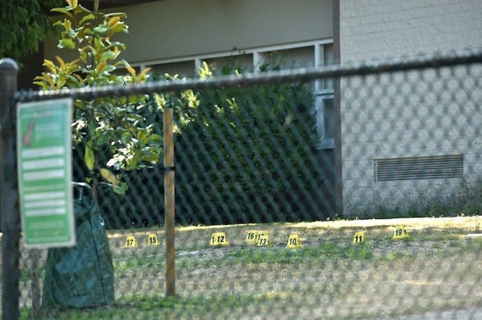 Evidence markers at the scene of Wednesday's night's shooting. Photo Dan Toulgoet
