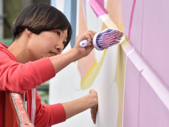 Artist Hanna Lee Joshi works on her contribution to this year's Vancouver Mural Festival, which runs Aug. 6 to 11. Photo Dan Toulgoet