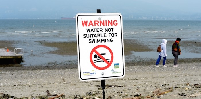 Signs advising people to stay out of the water went up at Jericho Beach, as well as English Bay and Sunset beaches, over the weekend after high levels of E. coli were detected in the water. Photo Jennifer Gauthier