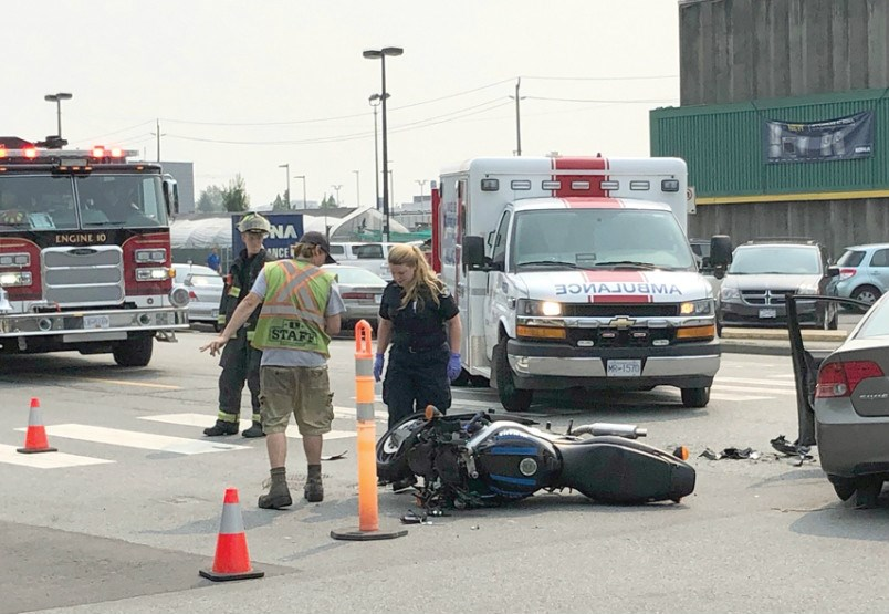 First Responders in North Vancouver deal with a crash on West 1st Street Monday. photo Brent Richter, North Shore News