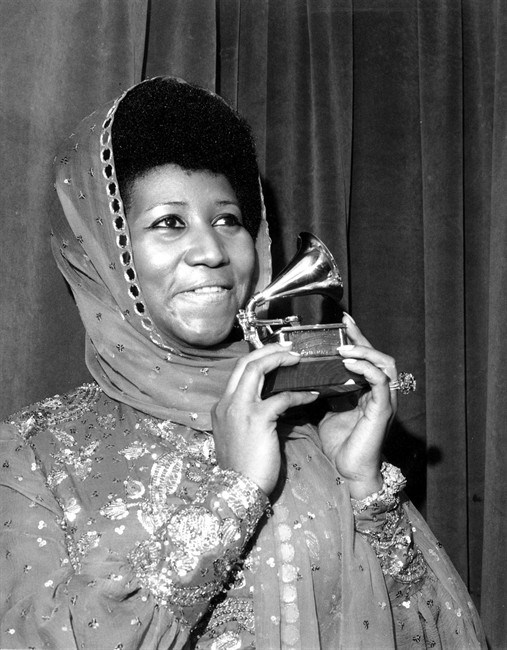 In this March 3, 1975 file photo, singer Aretha Franklin poses with her Grammy Award for for best female R&B vocal performance for