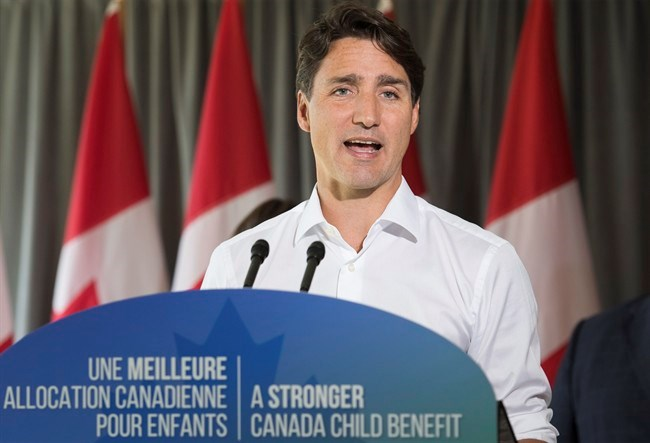 Prime Minister Justin Trudeau answers reporters questions during an event in Saint-Eustache, Que., Thursday, August 16, 2018. THE CANADIAN PRESS/Graham Hughes