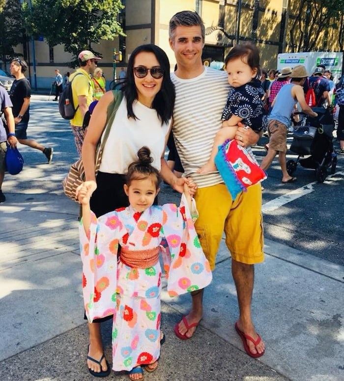 Brette Mullins with wife Noriko and their children Mila, 4, and Lio, eight months.
