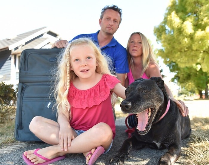 """Bryan Stewart with wife Andrea Robbie, daughter Sadie, 6, and their dog Maggie, 12. """"I have a good job here. But at some point you say, good job or not, what's left over is not enough,"""