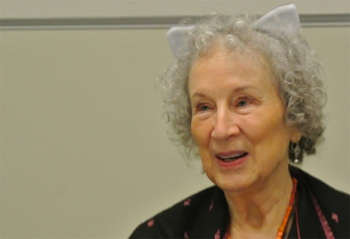 Margaret Atwood is the author of Angel Catbird, a graphic novel that seeks encourage people to keep cats — and therefor birds — safe by keeping cats indoors. Dressed in cat ears and and angel's wings, she was the keynote speaker at the International Ornithological Congress in Vancouver. This photo was taken at a media event earlier in the day.