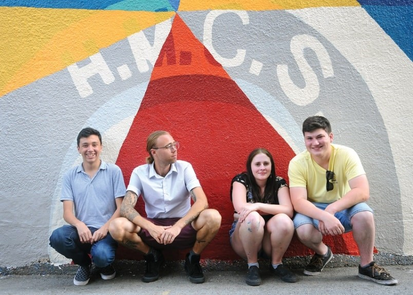 Liam McAdam, Mark Ollinger, Abby Graham and Harrison Clark in front of a section of the wall mural titled Laneway 45 at 119 East 3rd. St., North Vancouver. photo Cindy Goodman, North Shore News.