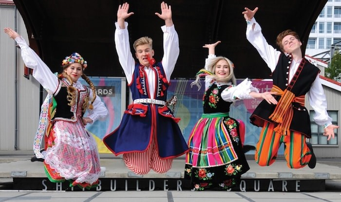 Dancers Alicja Cichecki, Patrik Slazkiewicz, Emilia Krupa and Nikodem Cichecki welcome the public to their September 9th celebration at Shipbuilders Square in Lower Lonsdale. (Photo by Cindy Goodman/North Shore News)
