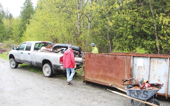 Reporting The BC Wildlife Federation has released an app that makes it easy to report an environmental crime, like illegal dumping. Memebrs of the Pemberton Wildlife Association are pictured cleaning up garbage around the Grean River Forest Service Road last spring. (Photo: submitted)