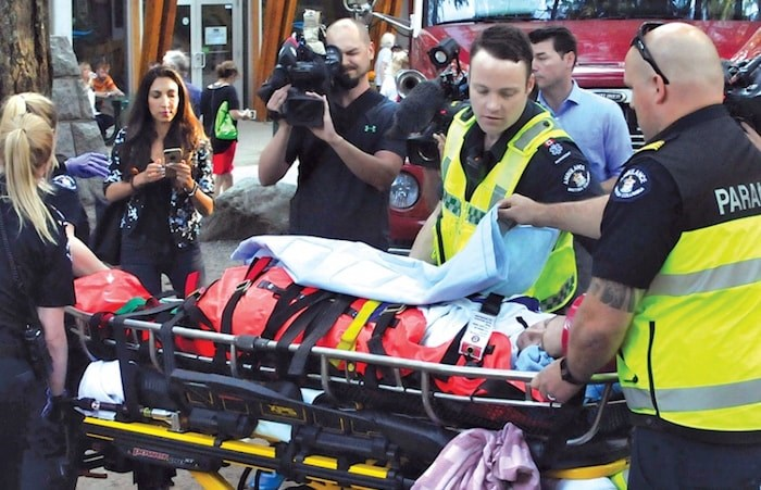 Paramedics prepare to transport a young woman injured in North Vancouver's Lynn Canyon late in the day on Wednesday. Photo: Paul McGrath, North Shore News