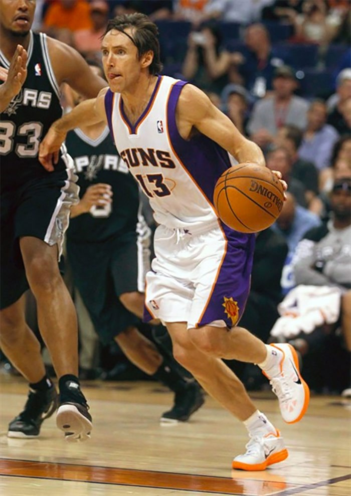 In this April 25, 2012, file photo, Phoenix Suns' Steve Nash (13) competes against the San Antonio Spurs during the second half of an NBA basketball game in Phoenix. When Nash is inducted into the Naismith Hall of Fame on Friday, his high school coach will be watching from Victoria, B.C., and beaming with pride. Ian Hyde-Lay says he feels lucky to have played a part in the all-star's career. THE CANADIAN PRESS/AP/Matt York, File)
