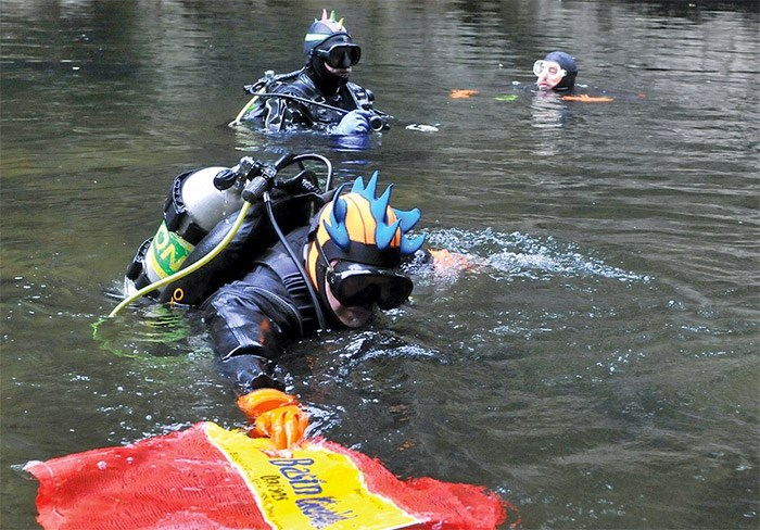 A group of nine divers from Divers for Cleaner Lakes and Oceans were cleaning up debris in the Cable Pools on the Capilano River last Saturday in co-operation with the North Shore Streamkeepers. They collected about 85 kilograms of old fishing gear and metal objects - photo Paul McGrath, North Shore News