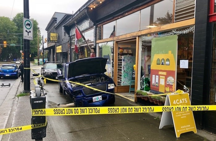 Vancouver police were pursuing the blue truck's driver, who had crossed the border without stopping, when the driver was involved in an accident at West 10th Ave. and Alma Street. Photograph By Craig Roberts