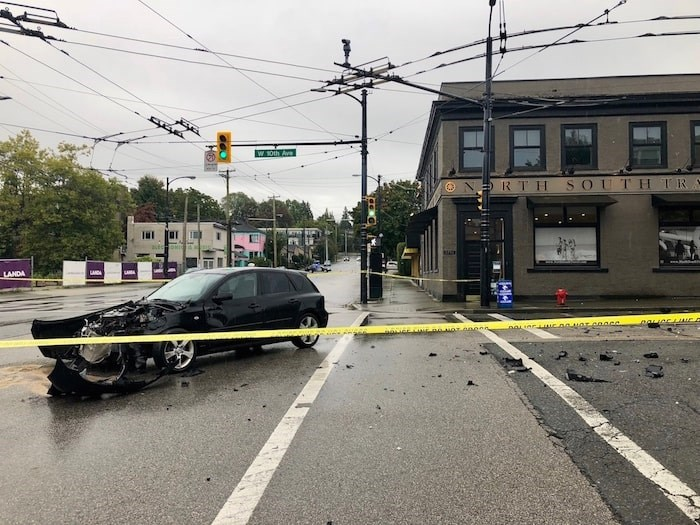 The 32-year-old Vancouver driver of this Mazda sustained minor injuries when his car was hit by a truck whose driver was trying to evade police. - Craig Roberts