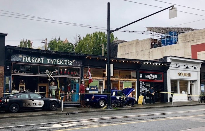 The blue truck crashed into stores after being involved in an accident West 10th Avenue and Alma Street during a Vancouver police pursuit. - Craig Roberts