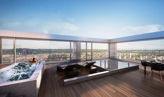 As the unit listed is south/south-east-facing, we're guessing this is a more accurate representation of the actual rooftop deck. Not too shabby... Listing agent: Karim Virani