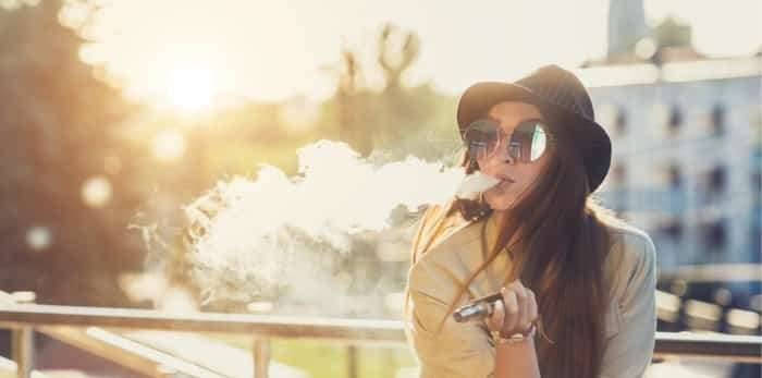 The province is expected to announce new regulations regarding youth vaping. Photo: Vaping woman / Shutterstock