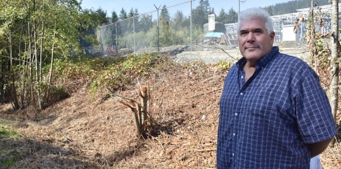 Michael Schmidt stands outside BC Hydro's Barnard Substation, where crews recently began clearing brush and trees. (Burnaby Now)